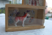 Dog in a box Recycled domino box with found object £9.00